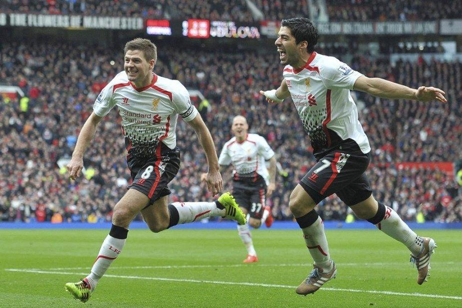 Steven Gerrard (8) avec deux buts et Luis... (PHOTO PAUL ELLIS, AFP)