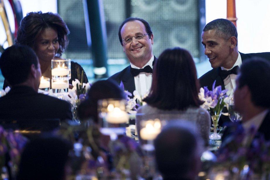 Michelle Obama, le président français François Hollande et... (Photo archives AFP)