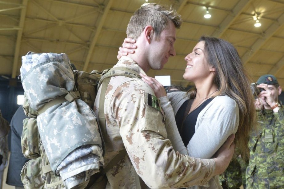 MCpl Anthony Alliot and Sarah Tooth embrace after...
