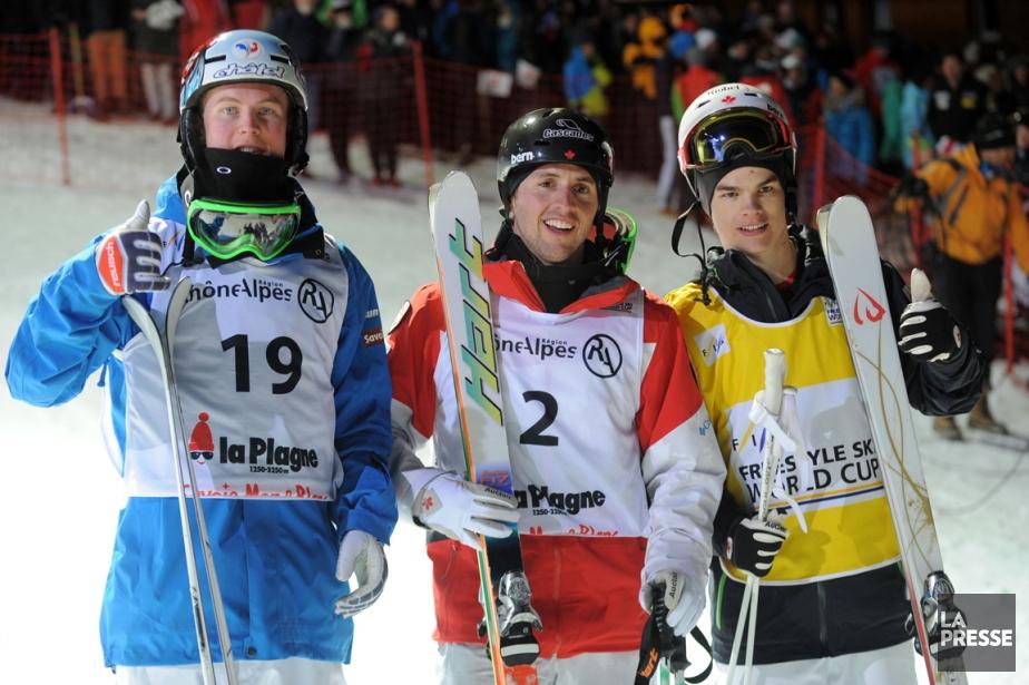 Alexandre Bilodeau (au centre) a triomphé à la... (Photo Jean-Pierre Clatot, AFP)
