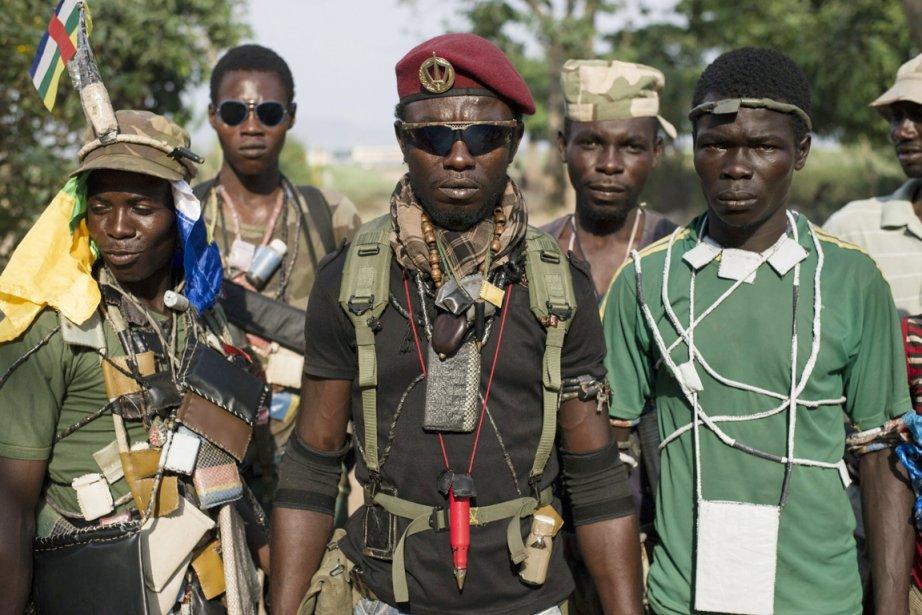 Formées en réaction aux exactions contre la population... (PHOTO FRED DUFOUR, ARCHIVES AFP)