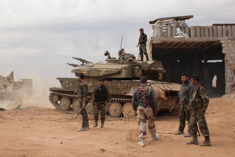 Des soldats de l'armée syrienne.... (Photo GEORGE OURFALIAN, archives Reuters)