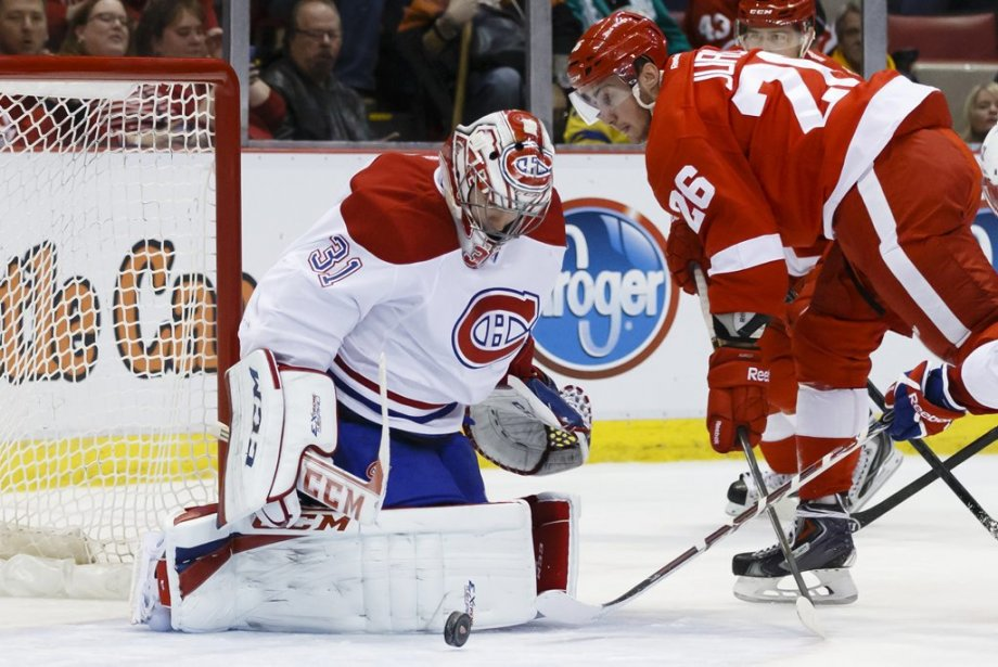 Carey Price se dresse devant Tomas Jurco. (Photo USA TODAY Sports)