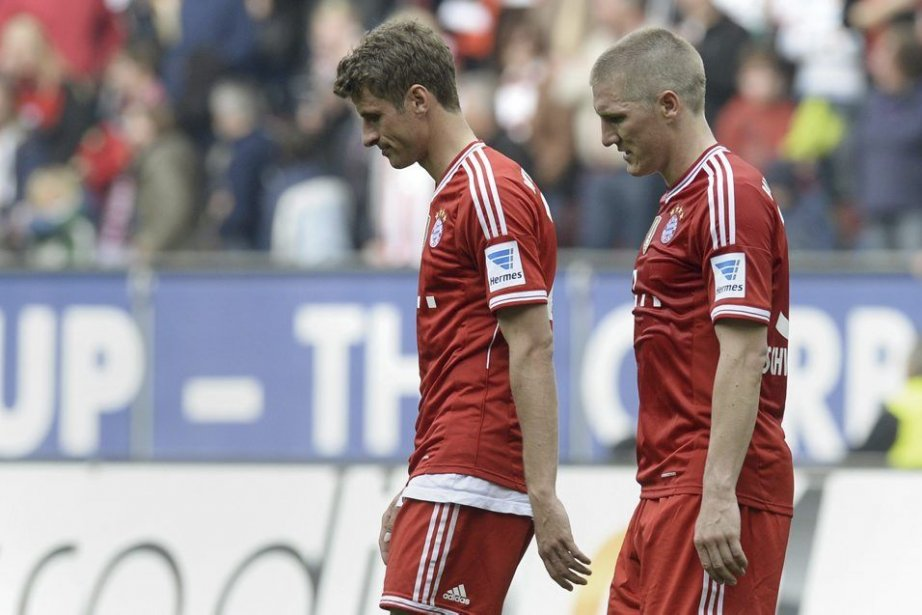 Thomas Mueller et Bastian Schweinsteiger... (PHOTO CHRISTOF STACHE, AFP)