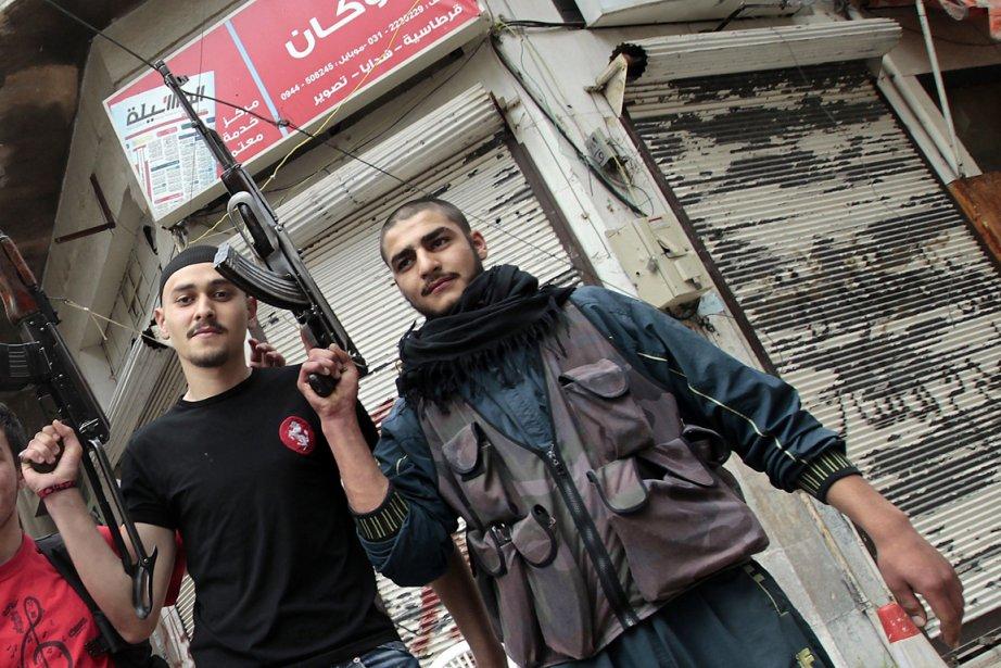 Des rebelles dans la ville de Homs, en... (Photo Joseph Eid, archives AFP)