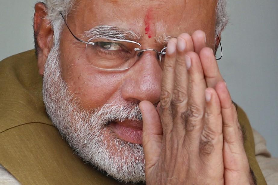 La victoire retentissante de Narendra Modi, 63 ans,... (Photo Saurabh Das, AP)