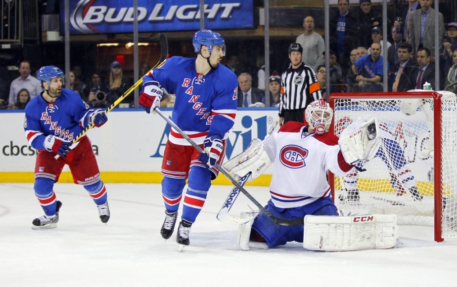 Chris Kreider et Martin St. Louis défient Tokarski. (Photo USA TODAY Sports)