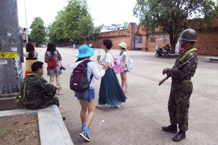 Les arrivées de touristes étrangers sur les quatre... (Photo Wichai Taprieu, AP)