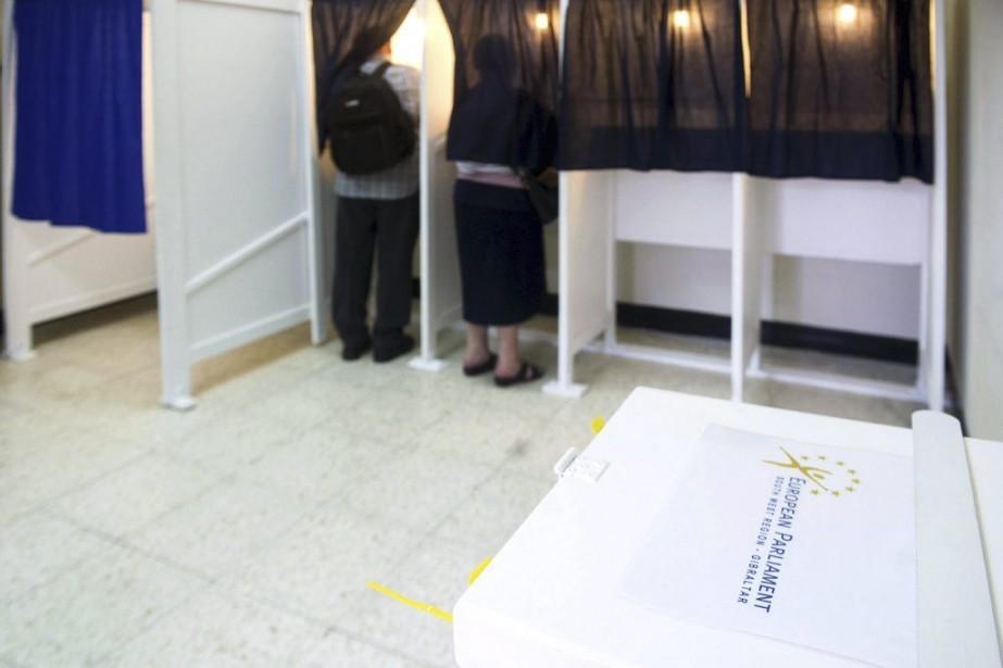 Les premiers résultats officiels du scrutin, étalé sur... (PHOTO MARCOS MORENO, AFP)