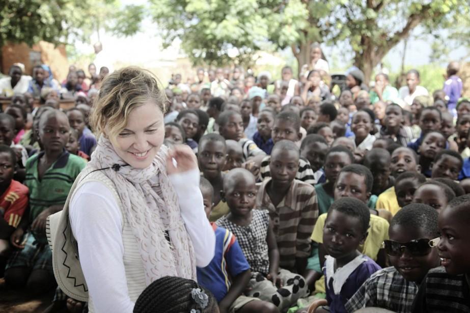 L'an dernier, un séjour de Madonna au Malawi... (PHOTO NATHAN RISSMAN, ARCHIVES REUTERS/LIZ ROSENBERG MEDIAS)
