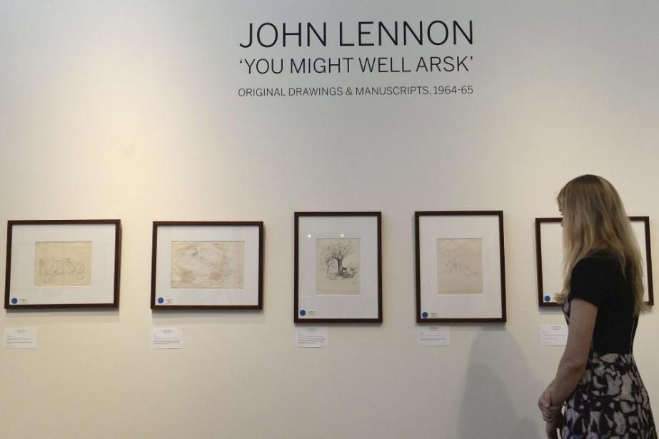 Des dessins et manuscrits de John Lennon datant des années 60,... (Photo: AFP)