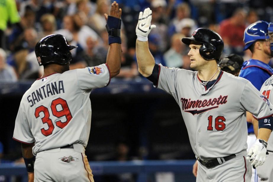 Josh Willingham (à droite), des Twins du Minnesota,... (Photo Dan Hamilton, USA Today)