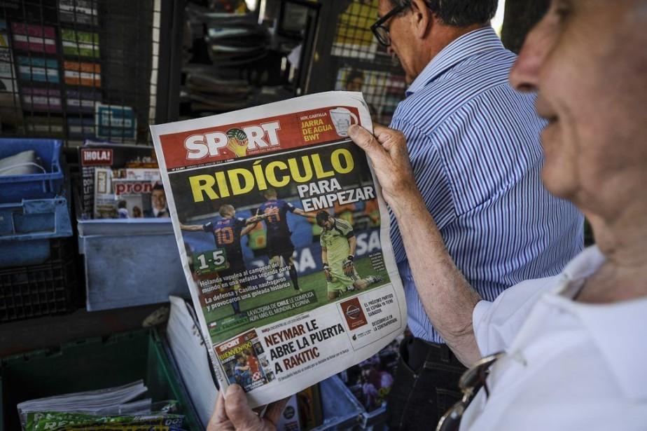 L'Espagne avait aussi perdu son premier match en... (Photo Alvaro Barrientos, AP)