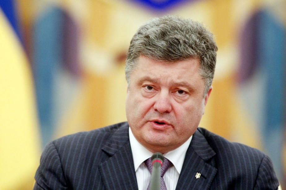 Le président ukrainien Petro Porochenko... (PHOTO VALENTYN OGIRENKO, ARCHIVES REUTERS)