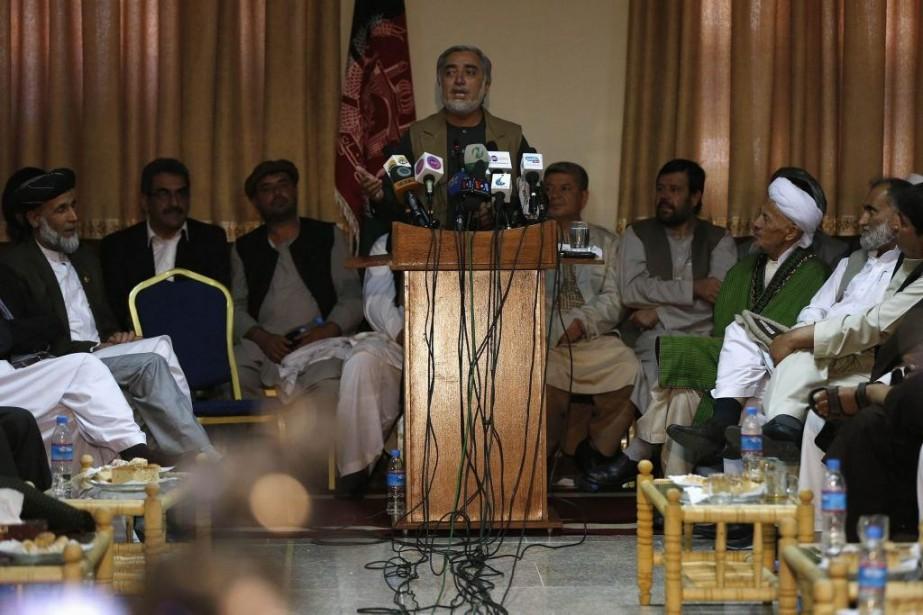 Abdullah Abdullah... (PHOTO OMAR SOBHANI, REUTERS)