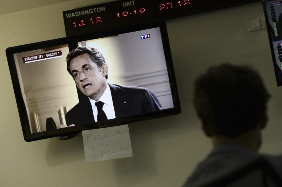 Le soir même, à la télévision, Nicolas Sarkoxy... (PHOTO STEPHANE DE SAKUTIN, AGENCE FRANCE-PRESSE)