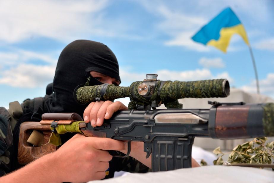 L'armée régulière, la Garde nationale et des unités... (PHOTO GENYA SAVILOV, AGENCE FRANCE-PRESSE)