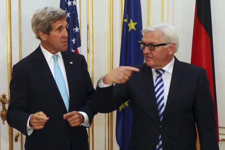 Le secrétaire d'État américain John Kerry en compagnie... (Photo Ronald Zak, AP)