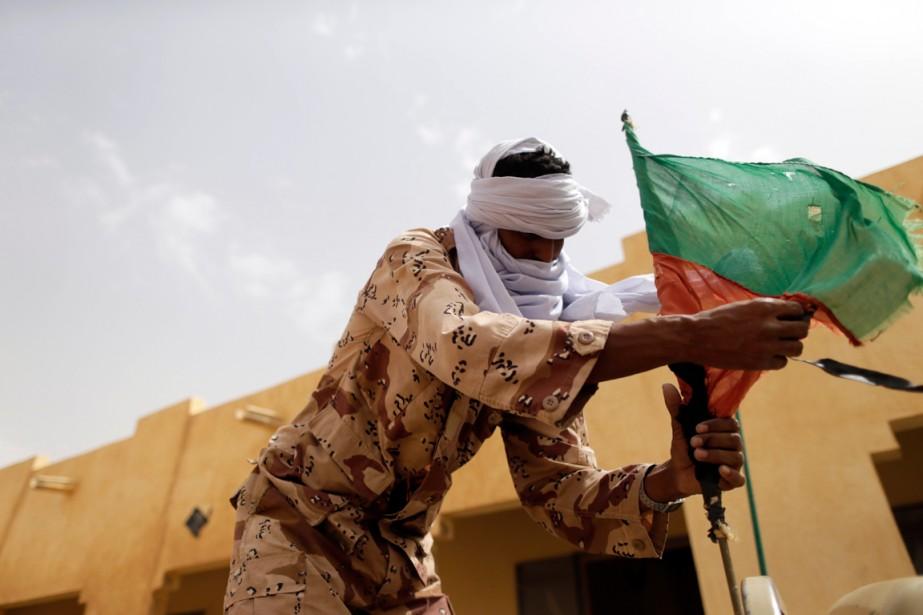 Un combattant du Mouvement national de libération de... (PHOTO  KENZO TRIBOUILLARD, ARCHIVES AGENCE FRANCE-PRESSE)