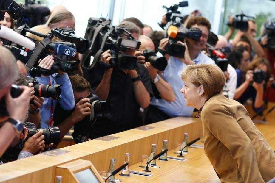Dans sa première longue conférence de presse depuis... (PHOTO THOMAS PETER, REUTERS)