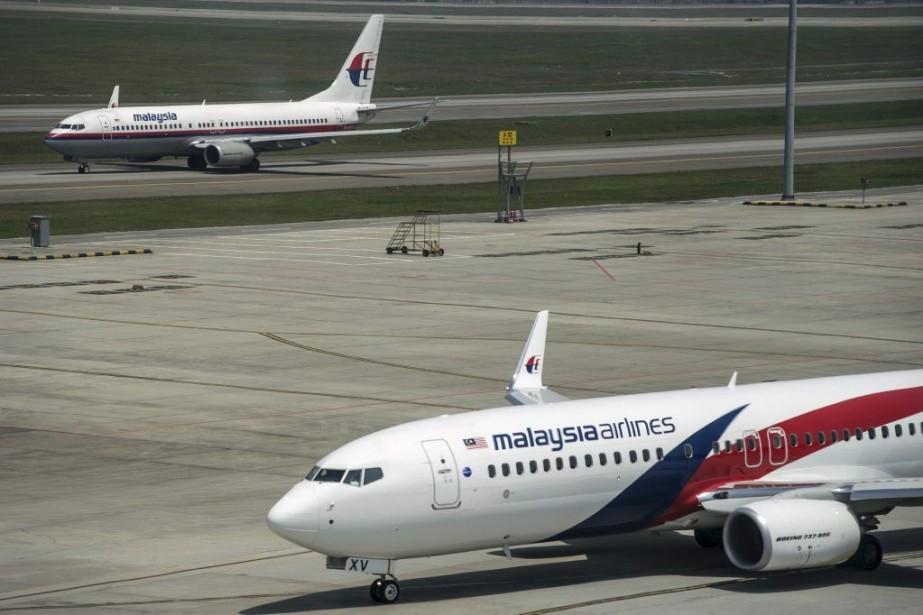 Deux vols de la compagnie Malaysia Airlines ont... (PHOTO MOHD RASFAN, ARCHIVES AFP)