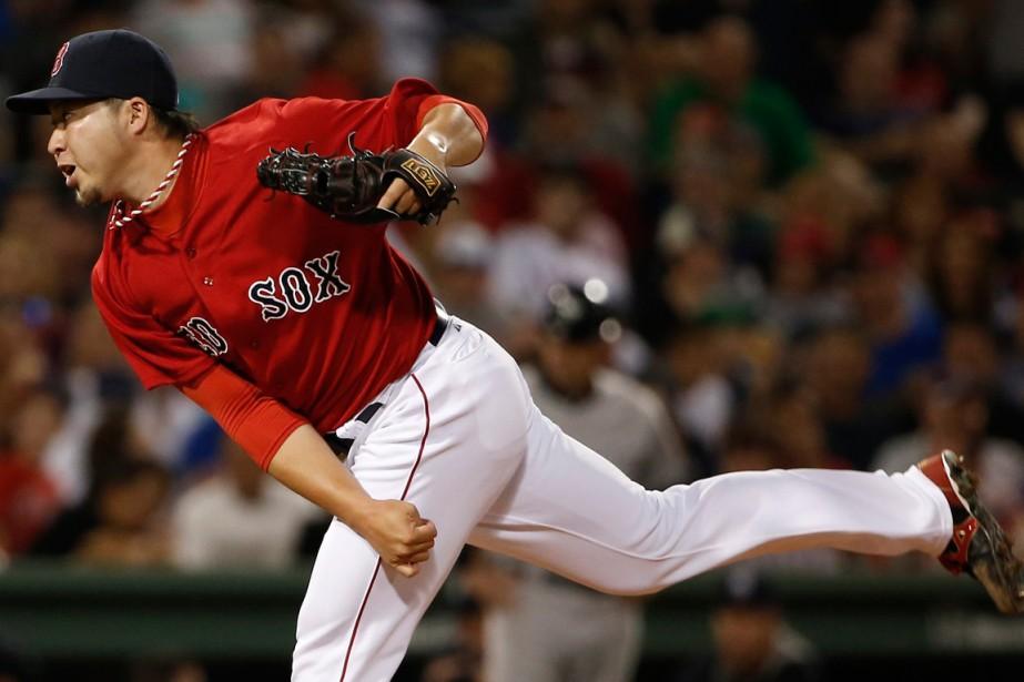 Junichi Tazawades Red Sox de Boston.... (Photo Winslow Townson, Associated Press)