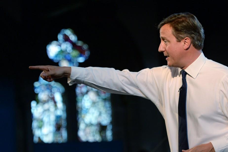 Le premier ministre britanniqueDavid Cameron a appelé samedi... (Photo STEFAN ROUSSEAU, AFP)