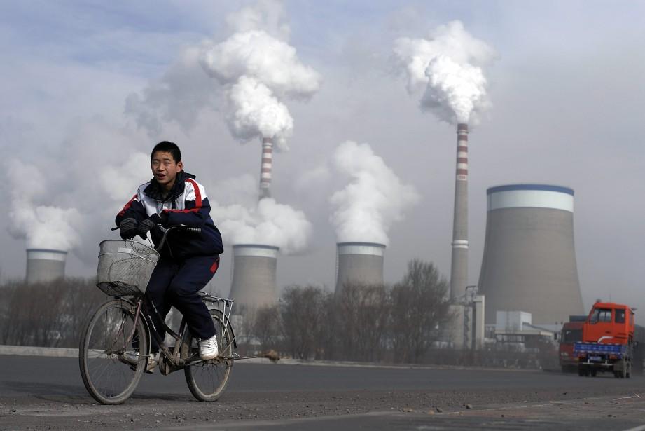 Le charbon constituait à lui seul le quart... (Photo Andy Wong, AP)