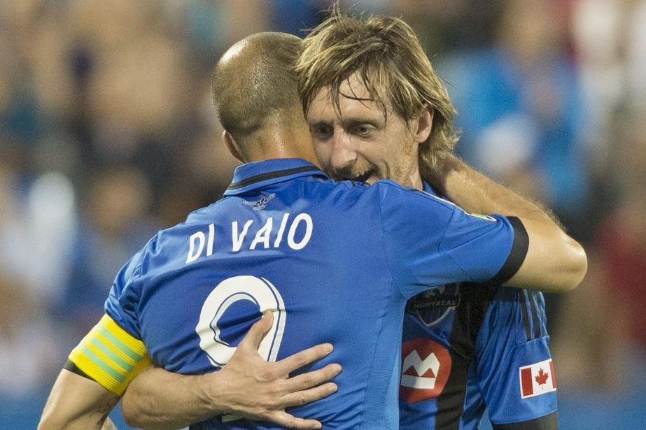 Marco Di Vaio festoie avec son coéquipier Gorka... (Photo Graham Hughes, La Presse Canadienne)
