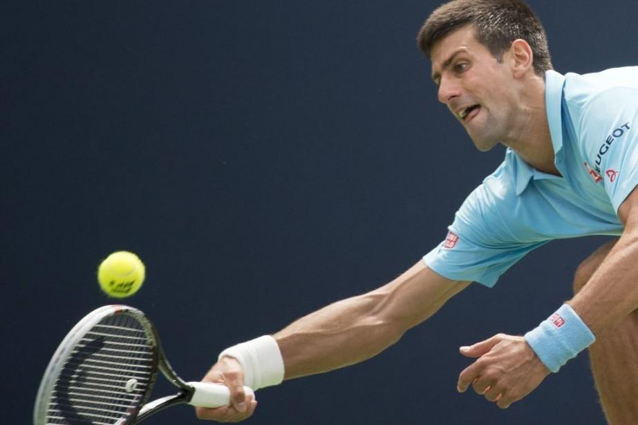 Djokovic a requis trois sets pour venir à... (Photo AFP)