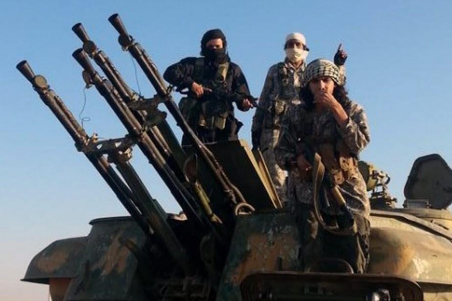 «Les rebelles essaient de viser des objectifs militaires... (Photo AP)