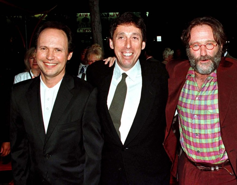 Billy Crystal, le réalisateur Ivan Reitman et Robin Williams lors de la première de<em>Father's Day</em>,à Hollywood, en 1997. (Reuters)