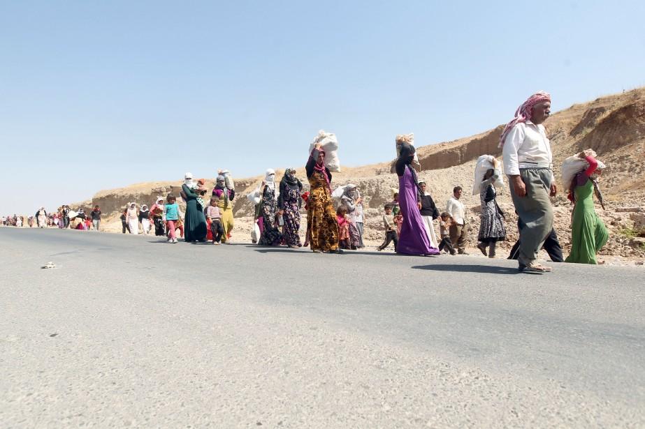 Des milliers de Yazidis ayant fuient les quartiers... (Photo AHMAD AL-RUBAYE, AFP)