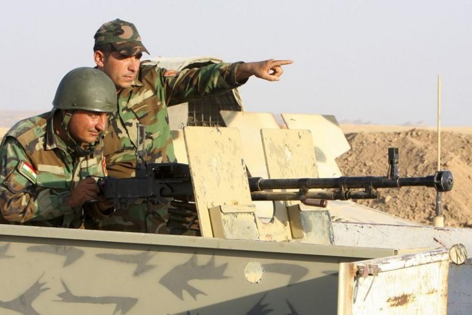 Les troupes kurdes participent aux combats contre les... (PHOTO REUTERS)