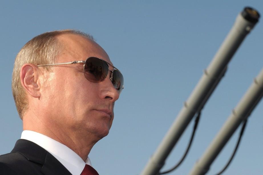 Le président russe Vladimir Poutine... (PHOTO ALEXEI DRUZHININ, ARCHIVES AFP)