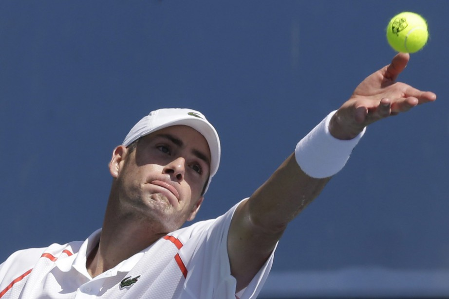 John Isner... (Photo Al Behrman, AP)