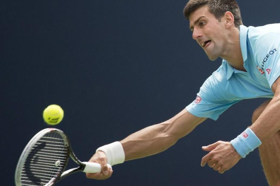 Novak Djokovic pourrait retrouver l'Américain John Isner au... (Photo AFP)