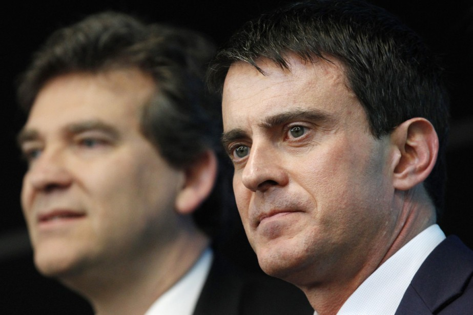 Le premier ministre Manuel Valls (à droite) avait... (PHOTO CHRISTOPHE ENA, ARCHIVES AFP)