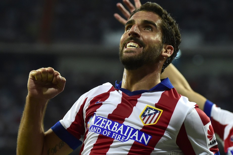 Le milieu de terrain de l'Atletico Madrid, Raul... (Photo Gérard Julien, AFP)