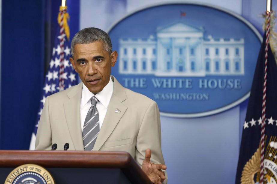 Le veston beige que portait Barack Obama jeudi... (Photo Reuters)