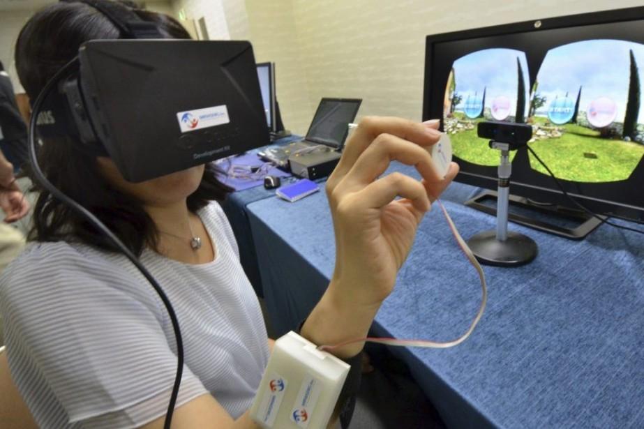 La technologie «3D haptique» mise au point par... (PHOTO YOSHIKAZU TSUNO, AGENCE FRANCE-PRESSE)