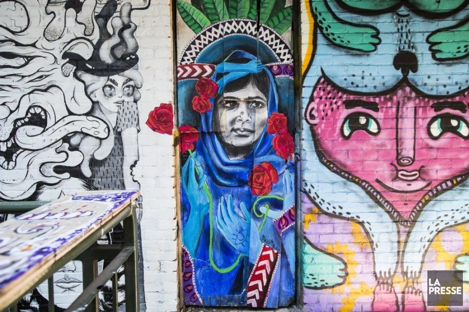 À côté d'un extrait d'une oeuvre du collectif En masse (créée en continu sur les trois étages du patio), celles des artistes Miss Me et Waxhead. (Photo: Olivier Pontbriand, La Presse)