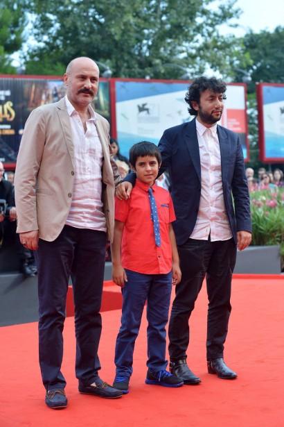 Jour 8 - Le réalisateur turc Kaan Mujdeci, en compagnie des acteurs Dogan Izci et Muttalip Mujdeci lors de la projection du film <em>Sivas</em>. (Photo: AFP)