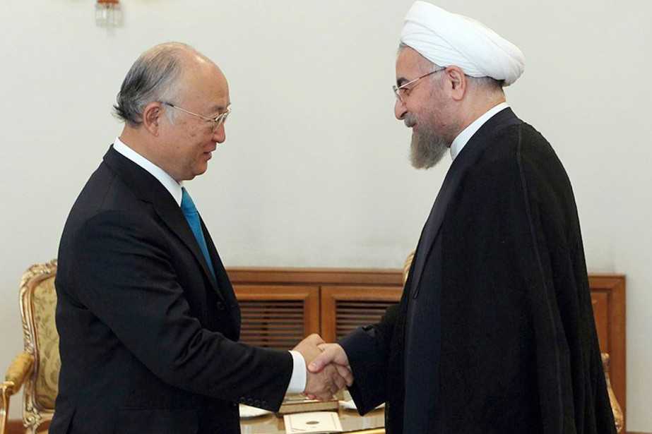 Le directeur général de l'AIEA,Yukiya Amano, rencontre le... (PHOTO MOHAMMAD BERNO, ARCHIVES AFP/PRÉSIDENCE IRANIENNE)