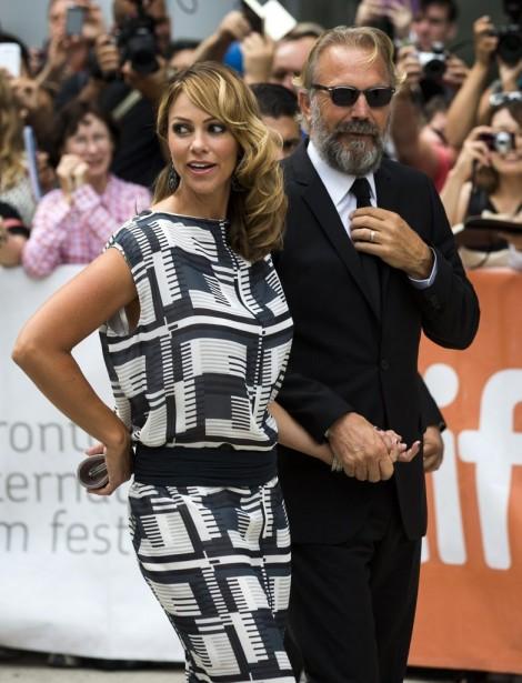 Jour 3 -Kevin Costner et sa femme Christine Baumgartner. (PHOTO MARK BLINCH, REUTERS)