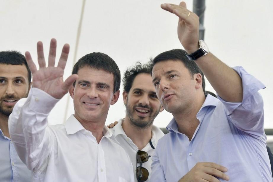 Le premier ministre français Manuel Valls (à gauche)... (PHOTO VINCENZO PINTO, AFP)