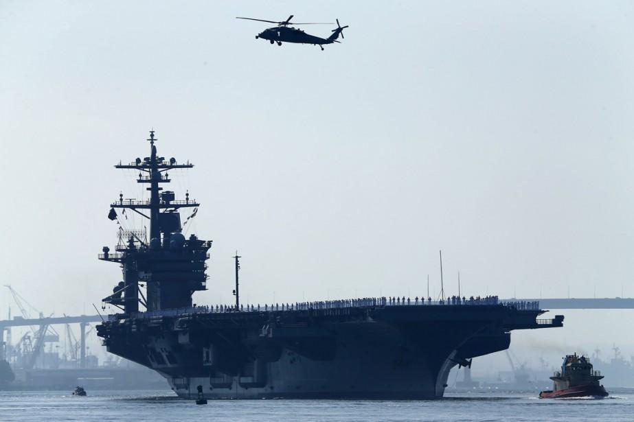 Les deux appareils, rattachés au porte-avionsUSS Carl Vinson... (PHOTO MIKE BLAKE, ARCHIVES REUTERS)