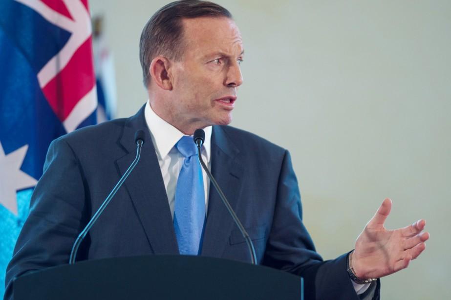 Ancien séminariste, Tony Abbott s'est illustré par son... (PHOTO MOHD RASFAN, ARCHIVES AFP)