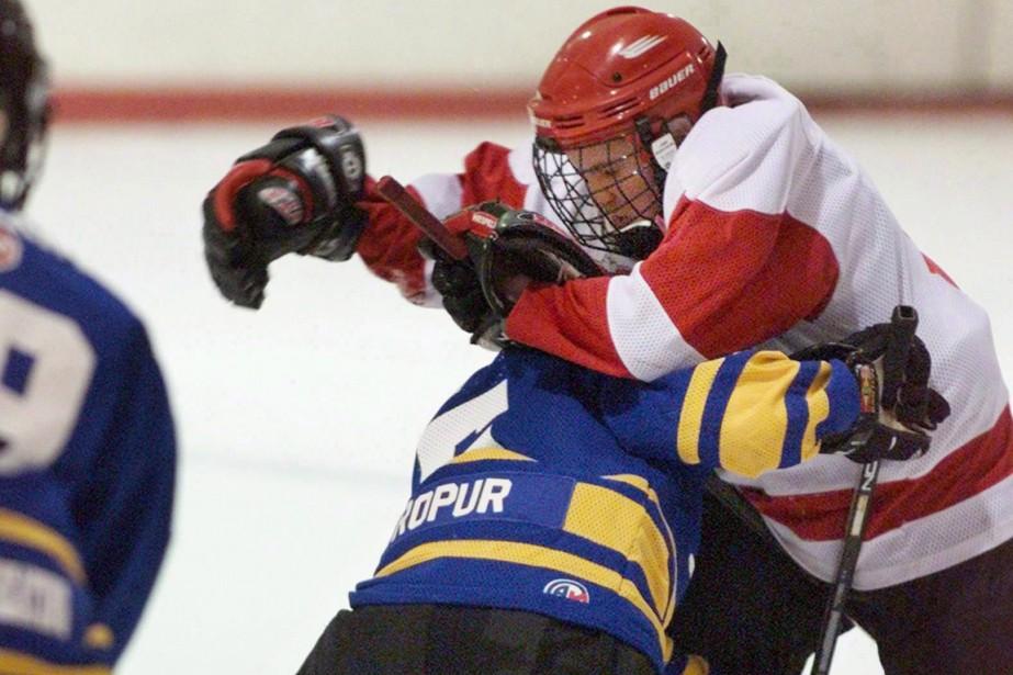 Les équipes sportives qui disposent d'un protocole d'intervention... (Photo Andrew Vaughan, archives PC)
