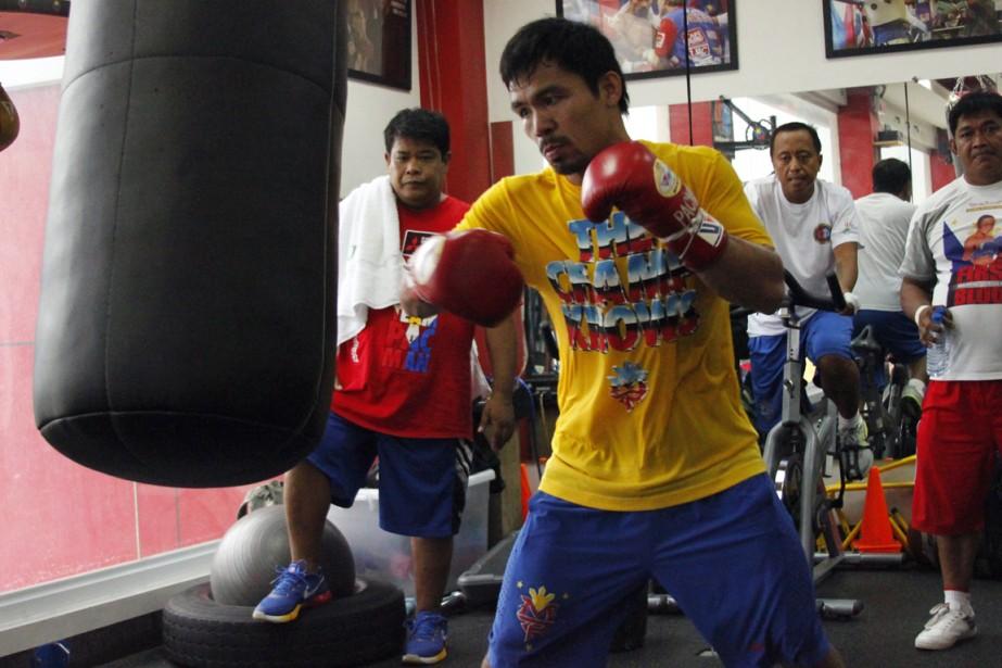 Manny Pacquiao s'entraîne présentement pour défendre son titre... (Photo AFP)